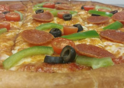 Greek style pizza at Arch 2 Sports Bar & Grill