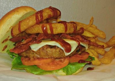 Angus Burger with cheese, bacon & onion rings